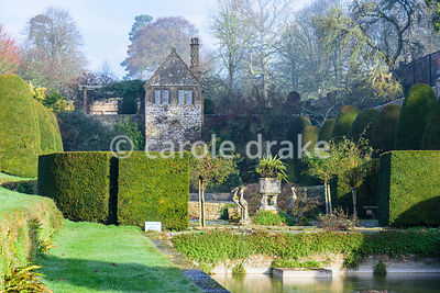 Bathing house at the head of the Canal Garden surrounded by clipped yew at Mapperton, Dorset