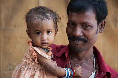 Portrait of a father and baby daughter along the Ganges River on Strand Rd, Kolkata, India.