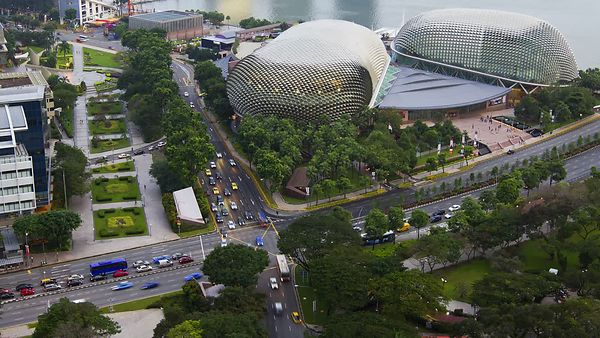 Close Up: Busy Intersection Outside The Esplanade (Day to Night)