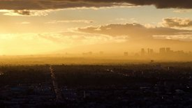 Bird's Eye: A Golden Spray Of Sun Rays & Clouds Over L.A.