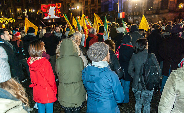 Amsterdam, Netherlands 2015-01-08: An estimated 18.000 people gathered on the Dam.