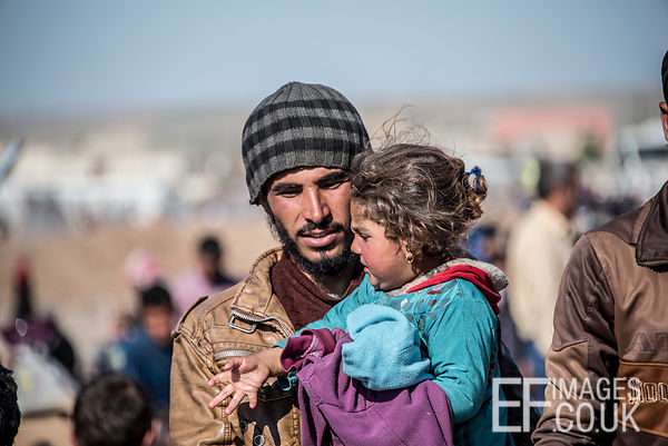 A Father Carrying His Daughter Arrive At Hamam al Alil Camp Having Escaped An ISIS Held Suburb Of Mosul Earlier That Day