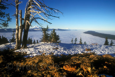 A cloud bank stretches for 100 miles north over the Cascades, from the summit of Black Butte, Oregon. From left to right are ...