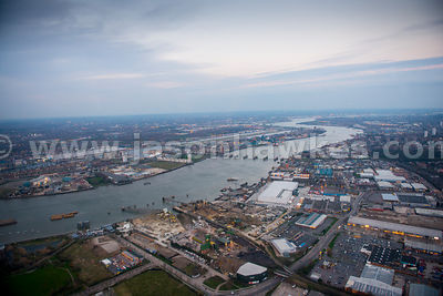 Aerial view of the Thames Barrier on the River Thames with City airport in background, London