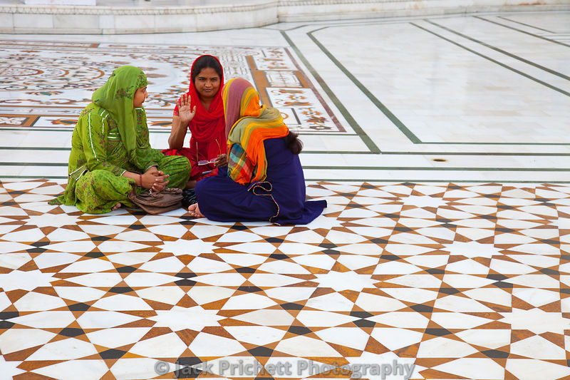 Sikh women converse at Golden Temple
