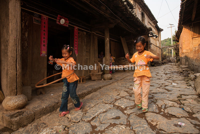 In the village of Yiwu, in Yunnan Province, children play on remnants of the original Southern Tea Horse Road, which began ne...