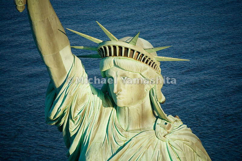 With a face said to have been modeled after the mother of her sculptor, Frederic Bartholdi, the Statue of Liberty wears a cro...