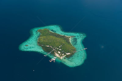 Aerial view of Jewelmer Pearlfarm platform on coral fringed island, Palawan, Philippines, May 2009, cultured Golden South Sea...