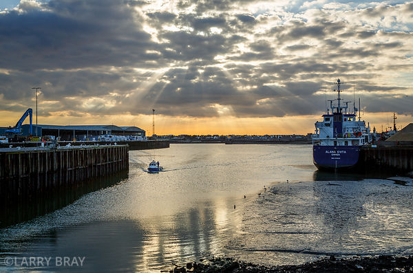 Rays of sun through clouds over Shoreham Harbour in Shoreham-by-Sea, West Sussex, UK