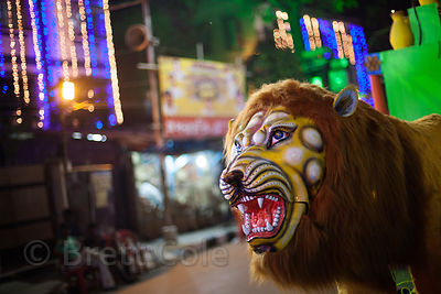 Figure of a lion on a street in Kalighat, Kolkata, India during the Durga Puja festival.