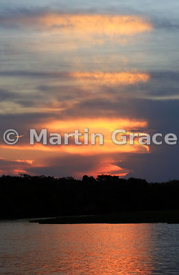 Spectacular colours as the sun sets over River Cuiabá, North Pantanal, Mato Grosso, Brazil