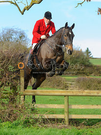 James Mossman MFH jumping a hunt jump