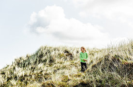 Danish girl playing in the dunes in Thy 11