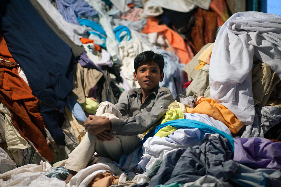 Boy working at a wholesale rag shop in Jodhpur, Rajasthan, India