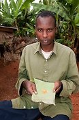 Man with honey which will be used in the home and sell also. Rwanda.
