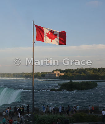 The Flag of Canada (Maple Leaf) flying by Canadian Horseshoe Falls, Niagara Falls, Ontario, Canada