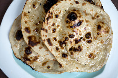 India - Delhi - A plate of chapati bread at the Village Restaurant