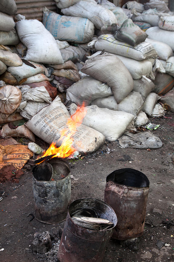 Flaming bucket on a street in the Dharavi slum, Mumbai, India.