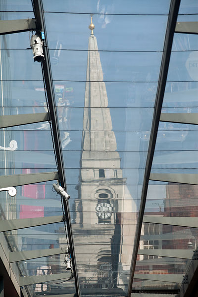 UK - London - The spire of Christ Church seen through the glass roof Spitalfields Market,
