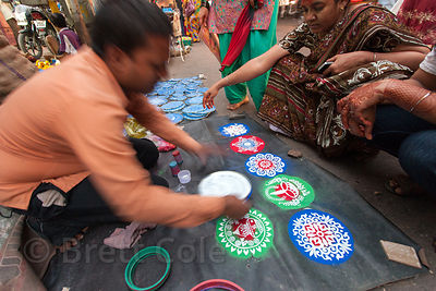 A man sells stencils that let you make designs with colored sand or powder, during the Ganesh Chaturthi festival, Lalbaug, Mu...