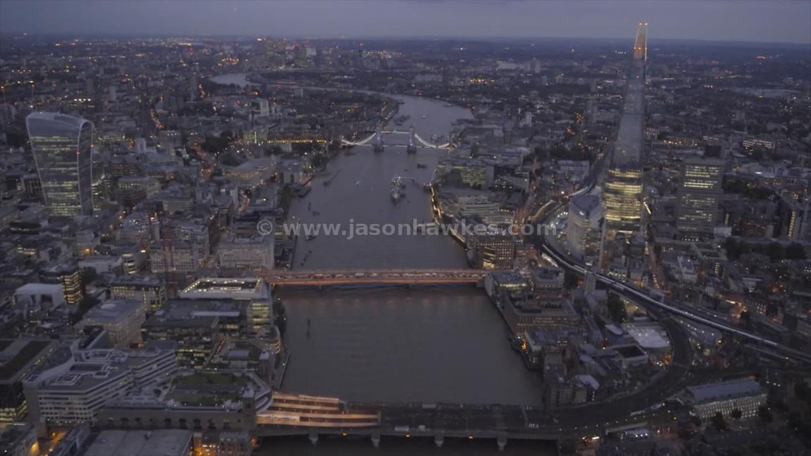 Aerial footage following the River Thames through Central London at night