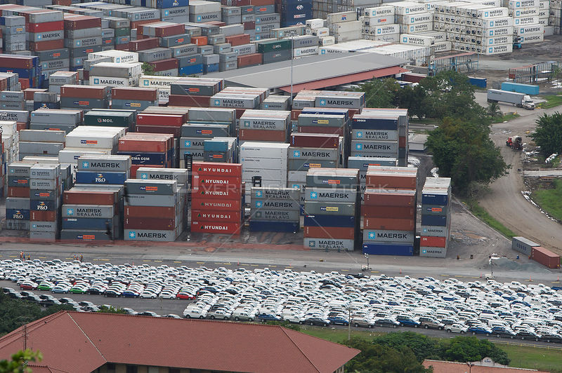 Cargo containers and cars waiting for transport at the port, Panama canal, Panama, November 2008