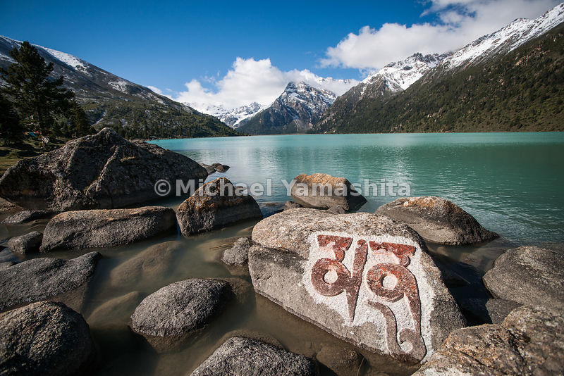 A Mani Prayer stone sits on the shore of Lhamo Latso, a lake sacred to Tibetans, at the foot of the Trola Mountain Range.