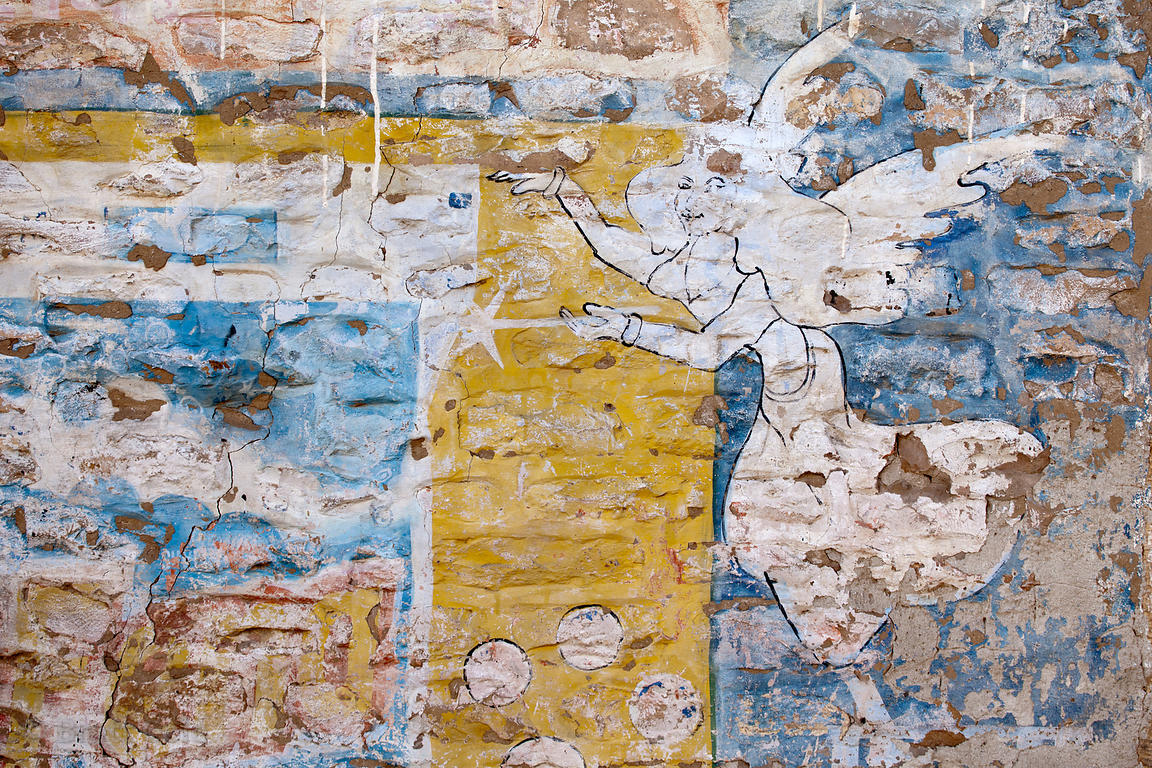 Faded painting on a brick wall in Jaisalmer, Rajasthan, India