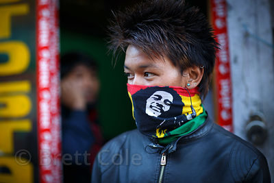 A young man wears a Bob Marley scarf in Leh, Ladakh, India