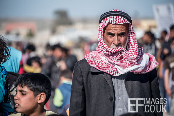 A Man Walks Down The Busy Main Thoroughfare Of The Hamam al Alil IDP Camp Near Mosul