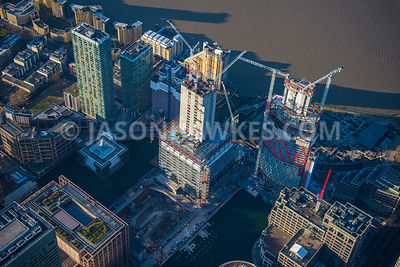 Aerial view of London, Docklands, construction of Newfoundland Tower and Landmark Pinnacle.
