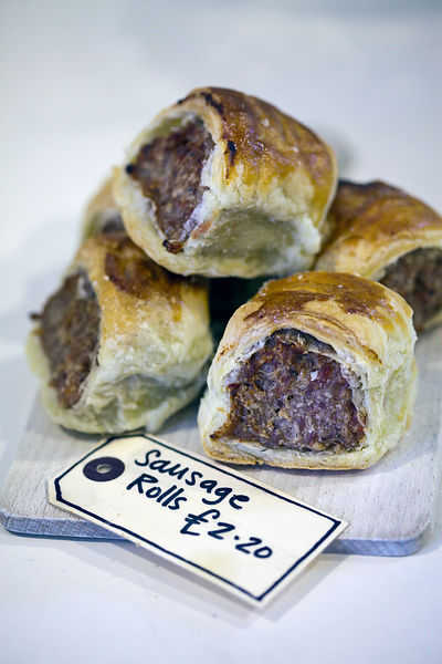 UK - London - Details of sausage rolls in A. Gold, a deli in Spitalfields Market,