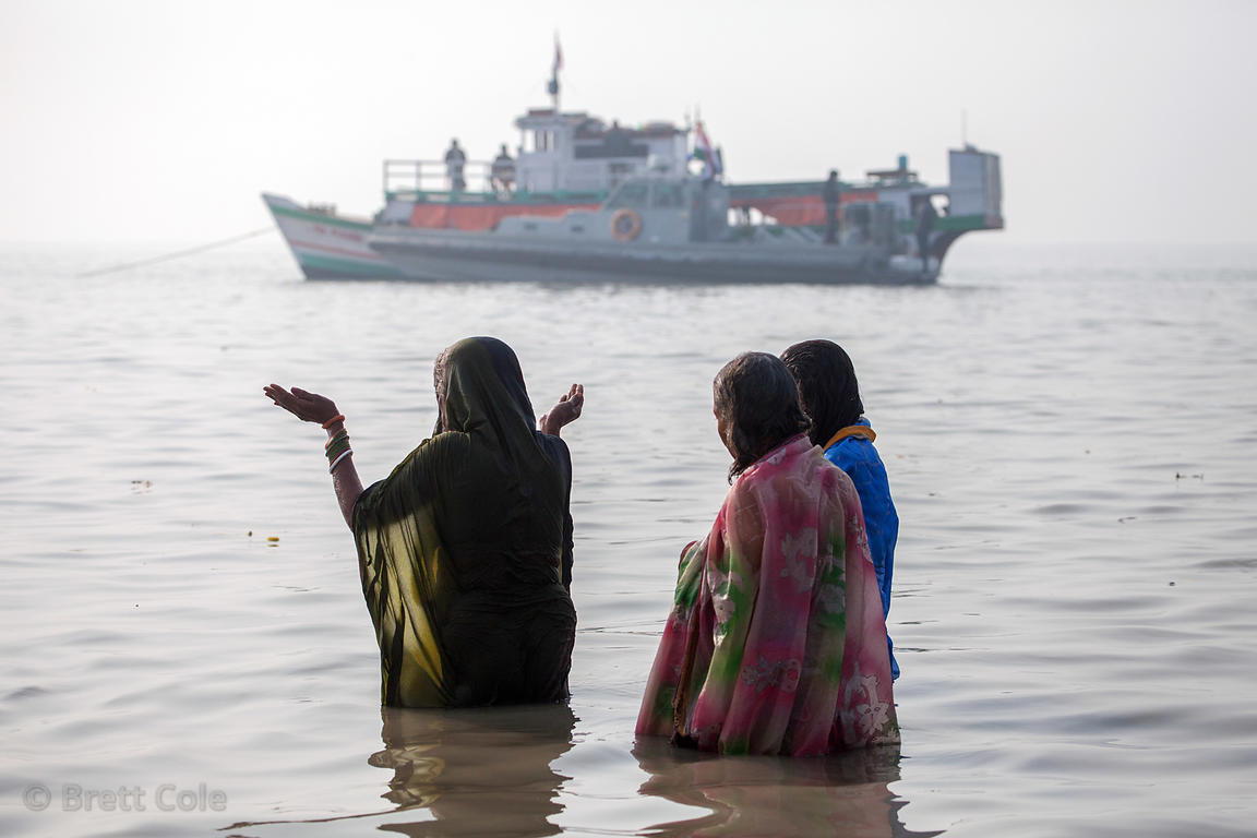 A group of women bathe and pray in the Bay of Bengal at the Gangasagar Mela (festival), a pilgrimage to Sagar Island in India...
