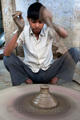 Potter making small dishes to hold candles, Udaipur, Rajasthan, India