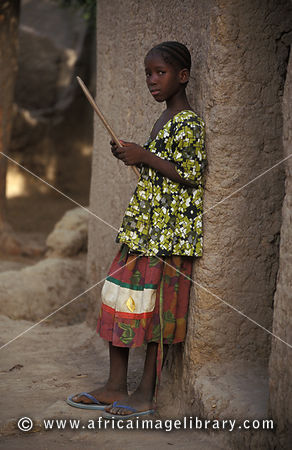 Girl with praying board at the Koran school, Djenné, Mali