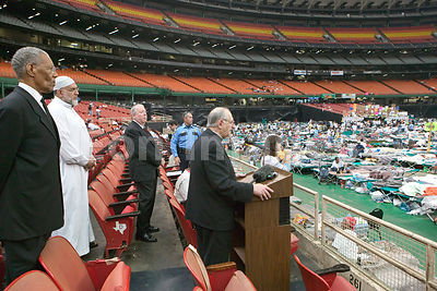Clergy speak to Hurricane Katrina survivors at Houston Astrodome