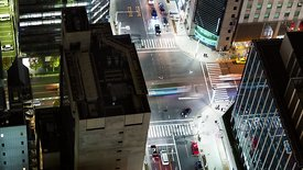 Bird's Eye: A Close Up of a Tokyo Intersection At Night