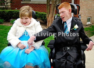 Two Disabled Friends Sitting On Wheelchair Playing With Each Other