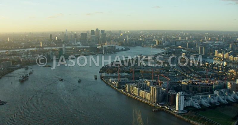 Aerial footage of the River Thames between the Royal Docks and Greenwich Peninsula