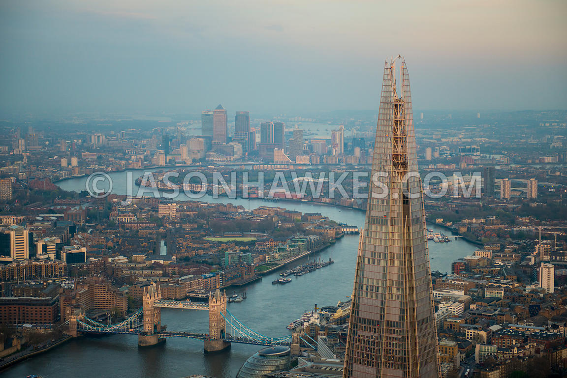 Aerial view of The Shard with Tower Bridge in the background, London