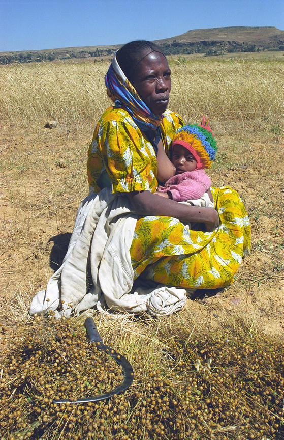 Farmer woman and baby