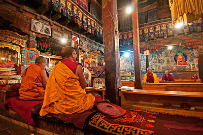 Buddhist monks pray in a monastery in Ladakh.