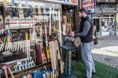 Knive sharpener at work, close to the spice market, Istanbul