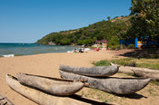 Dugout canoes lying on the beach of Lake Malawi, Nkhata Bay, Malawi