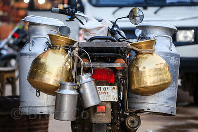 Metal milk jugs on the back of a motorcycle, Badi Basti, Pushkar, Rajasthan, India