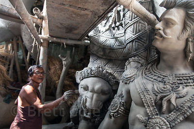 Museum quality Durga Puja idols being made from mud in Kumartoli (Potter's Town), Kolkata, India.