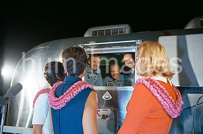 (27 July 1969) --- The Apollo 11 crewmen, still under a 21-day quarantine, are greeted by their wives.