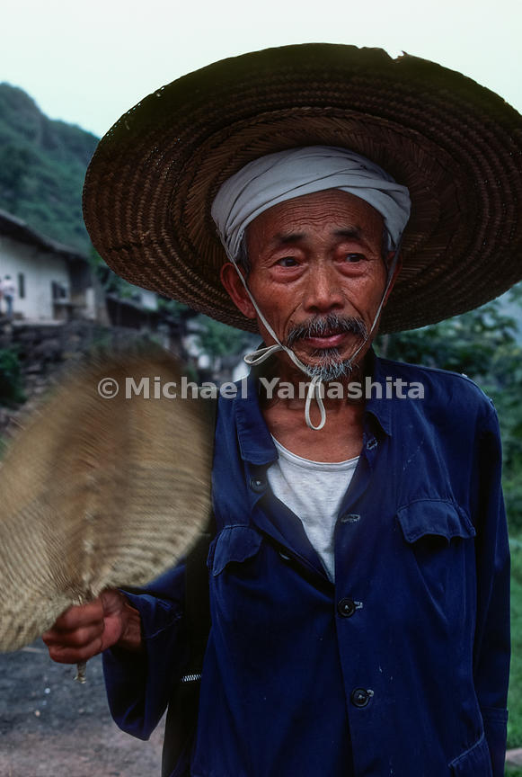 An elderly man fans himself in Ta Ping Do,.Guizhou, China.