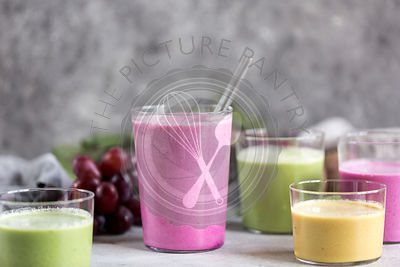 Glasses of Multi-Colored Beet Smoothies are photographed from the front view.