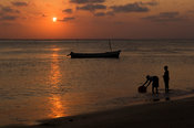 Mozambique, Beira, beach scene at sunset.